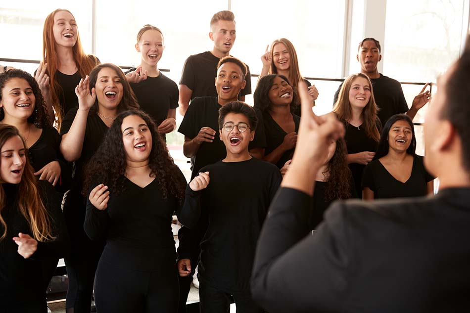 happy singing choir with conductor